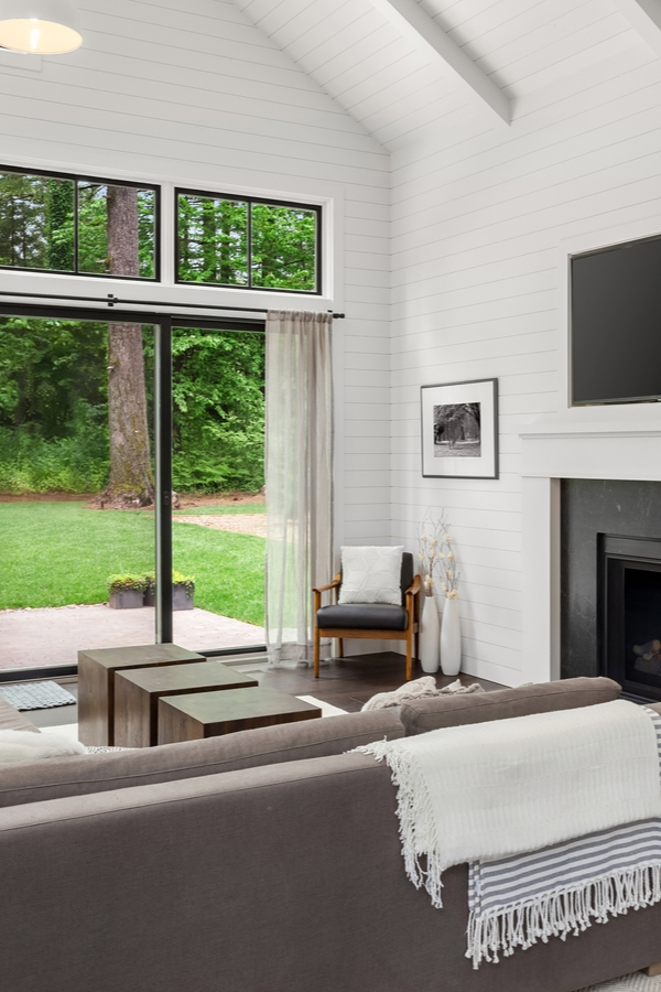 What are your favorite elements of modern farmhouse design? One of my favorite elements is a modern farmhouse fireplace with shiplap. If you need inspiration for a new build or ways to give your existing fireplace more appeal, these modern farmhouse fireplace ideas are sure to inspire you. Nothing looks better than a classic black and white wall and fireplace.