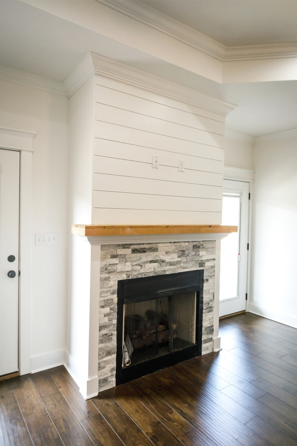 What are your favorite elements of modern farmhouse design? One of my favorite elements is a modern farmhouse fireplace with shiplap. If you need inspiration for a new build or ways to give your existing fireplace more appeal, these modern farmhouse fireplace ideas are sure to inspire you. We'll even show you how to install the shiplap.
