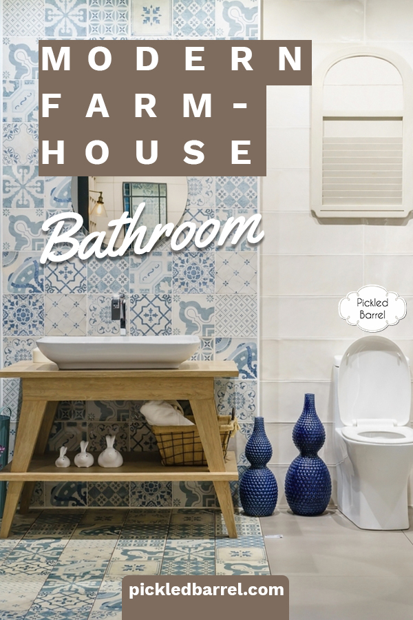 I'm in love with the farmhouse look. Especially a farmhouse bathroom. This post shares must-have elements for that look. From tile, to shelves, mirrors and more, you will definitely understand what your bathroom needs. For more farmhouse bathroom inspiration, keep reading. #farmhousebathroomdesign #elementsofarmhousebathroooms #homedesign #farmhousedecor