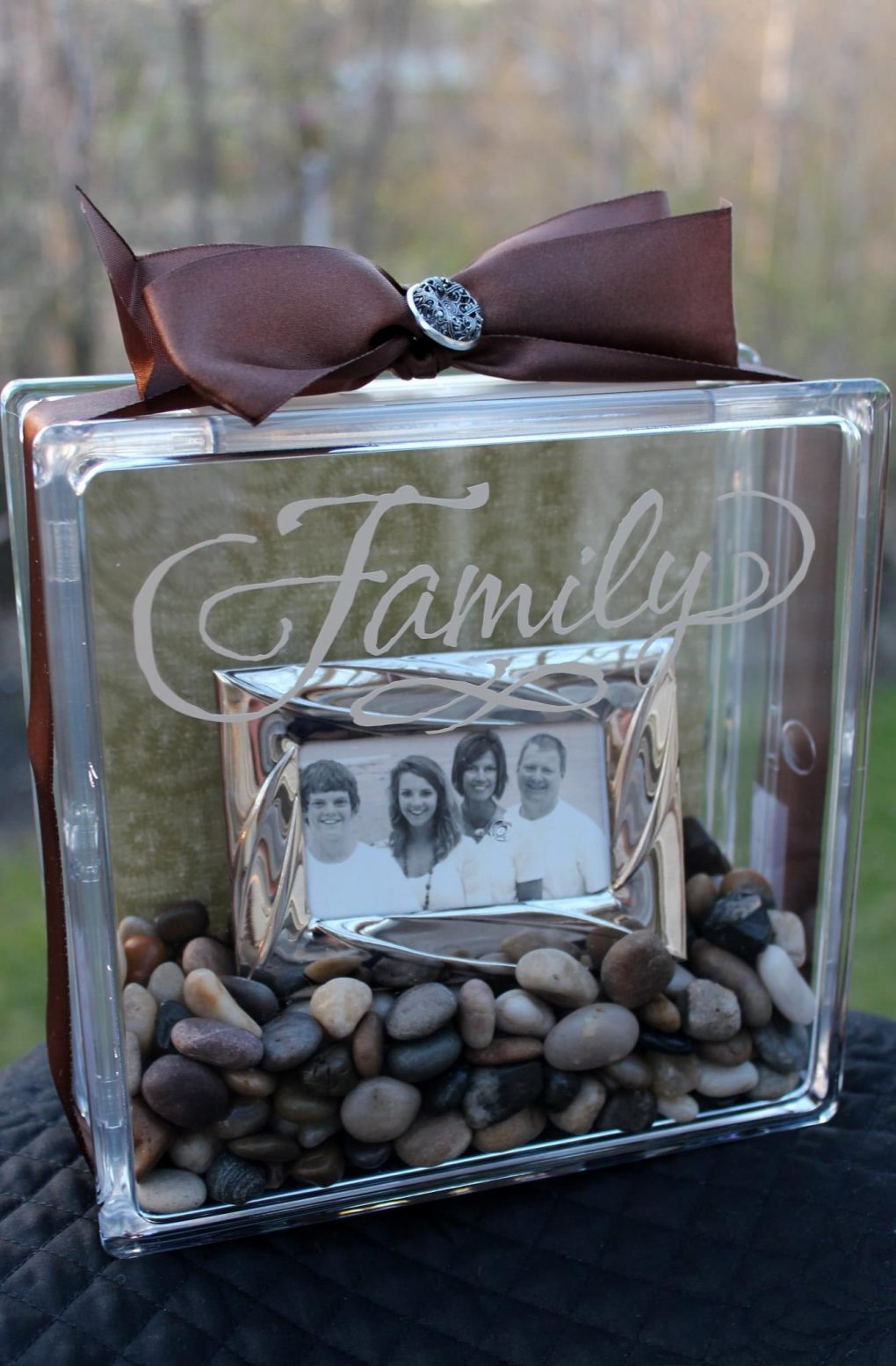 Glass block crafts-block filled with small pebbles and a framed family photo. Bow is tied around the block.