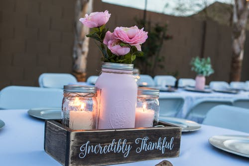 mason jars with candles and flowers