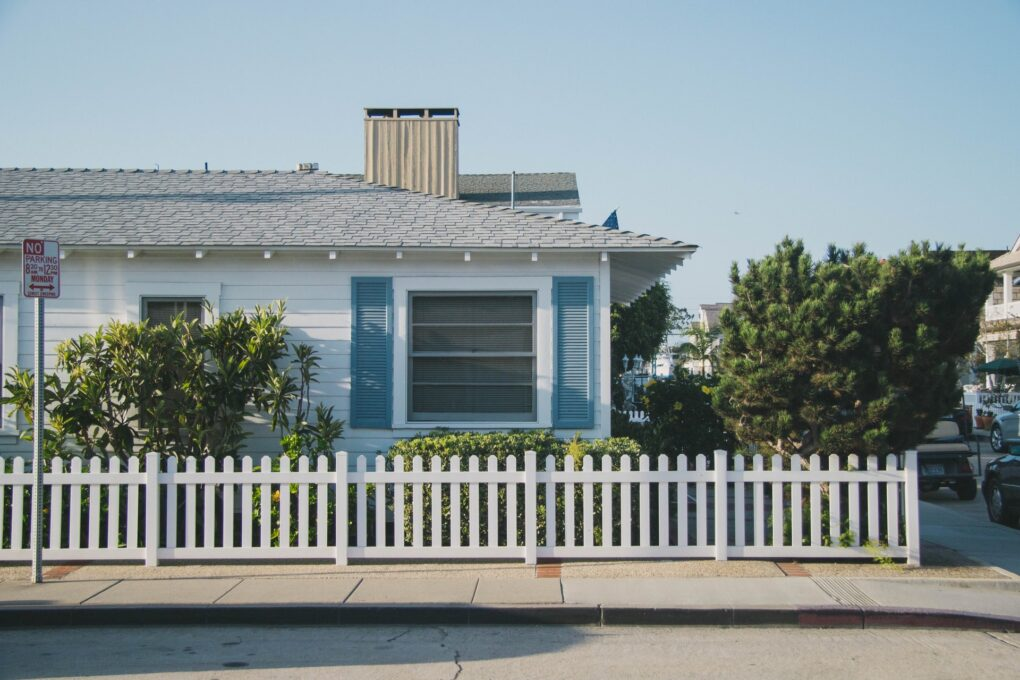 White picket fence for a modern farmhouse landscape